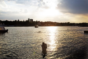 Warsaw. A man during a bath on the eastern bank of Wisla River | 2015
